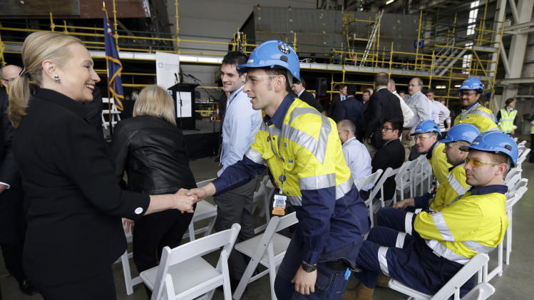 U.S. Secretary of State Hillary Rodham Clinton, left, meets with shipbuilders at the Techport Australia shipbuilding facility Thursday near Adelaide, Australia Thursday, Nov. 15, 2012. (AP Photo/Matt Rourke, Pool)