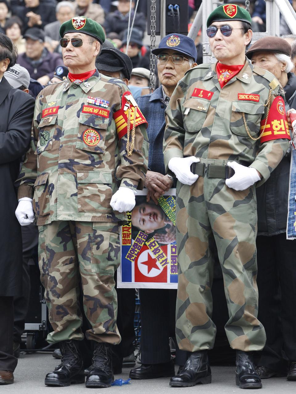 South Korean war veterans take part in an anti-North Korea rally in Seoul, South Korea, Friday, March 16, 2012. North Korea announced Friday it will launch a long-range rocket mounted with a satellite in honor of late President Kim Il Sung's April birthday. (AP Photo/Lee Jin-man)