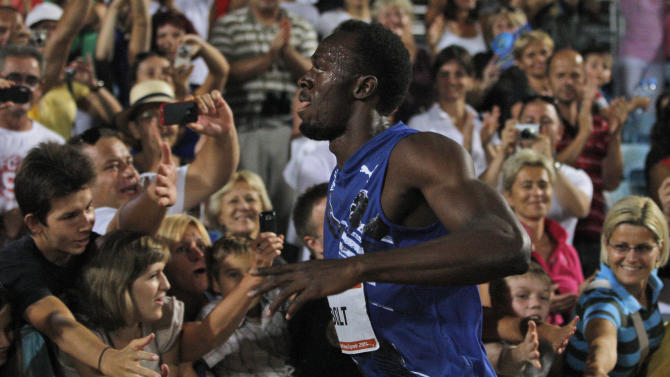 Jamaica's Usain Bolt runs past the audience after winning the men's 100m at the Zagreb Meeting IAAF World Challenge in Zagreb, Croatia, Tuesday, Sept. 13, 2011. (AP Photo/Darko Bandic)