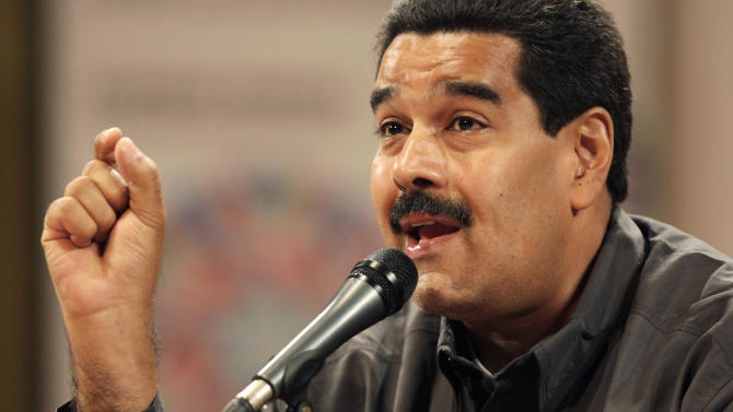 Venezuela's acting President Nicolas Maduro speaks at the opening of the Ninth International Book Fair of Venezuela (Filven) which pays tribute to late President Hugo Chavez at the Teresa Carreno theater in Caracas, Venezuela, Wednesday, March 13, 2013. Maduro announced on March 5 that Chavez had died, after a nearly two-year bout with cancer. He was 58. (AP Photo/Ariana Cubillos)