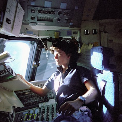 FILE - In this June 1983 photo released by NASA, astronaut Sally Ride, a specialist on shuttle mission STS-7, monitors control panels from the pilot&#39;s chair on the shuttle Columbia flight deck. Ride, the first American woman in space, died Monday, July 23, 2012 after a 17-month battle with pancreatic cancer. She was 61. (AP Photo/NASA, File)