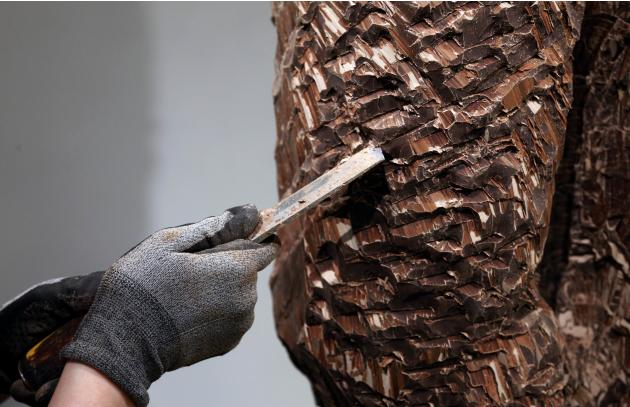 Sculptor Dewitte of France carves a chocolate model of the famous Belgian statue Manneken Pis in Brussels