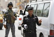 Iraqi police and internal security forces stop cars at a checkpoint in central Baghdad in July 2012. Iraq attacks mainly targeting security force personnel killed at least 33 people on Thursday, officials said, after government figures showed July was the bloodiest month in almost two years