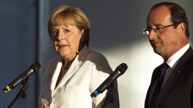 Germany's Chancellor Angela Merkel, left, and France's President Francois Hollande brief the media prior to a meeting at the chancellery in Berlin, Thursday, Aug. 23, 2012 .The leaders of Germany and France are stressing that it's up to Greece to keep pursuing painful reforms as it strives to keep its place in the euro. Chancellor Angela Merkel and President Francois Hollande were meeting Thursday before both hold talks over the next two days with Greece's new prime minister, Antonis Samaras. (AP Photo/Markus Schreiber)