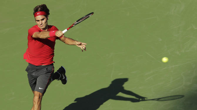 Roger Federer of Switzerland returns a shot to Novak Djokovic of Serbia during a semifinal match at the U.S. Open tennis tournament in New York, Saturday, Sept. 10, 2011. (AP Photo/Charlie Riedel)