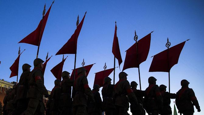 Russian troops march through the Red Square during a rehearsal for the Victory Day military parade which will take place at Moscow's Red Square on May 9 to celebrate 70 years of the victory in WWII, in Moscow, Russia, Monday, May 4, 2015. (AP Photo/Pavel Golovkin)