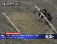 In this frame grab image taken from WCBS-TV, survivors cling to the bottom of a helicopter after it inverted following a crash in the East River in New York, Tuesday Oct. 4, 2011. The New York Police Department says the helicopter with five people aboard crashed into the river after taking off from a nearby heliport. The pilot and three others were pulled from the water shortly by rescue crews after it went down. Authorities were still searching for one other passenger, believed to be female, but the helicopter was fully submerged. (AP Photo/WCBS-TV) MANDATORY CREDIT WCBS-TV
