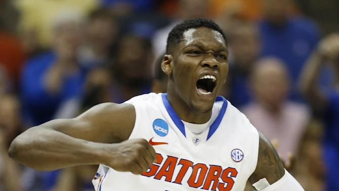 Florida guard Michael Frazier II (20) celebrates a goal against UCLA during the second half in a regional semifinal game at the NCAA college basketball tournament, Thursday, March 27, 2014, in Memphis, Tenn. (AP Photo/John Bazemore)