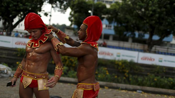 Revellers get ready before the first night of the Carnival parade of samba schools in Rio de Janeiro's Sambadrome