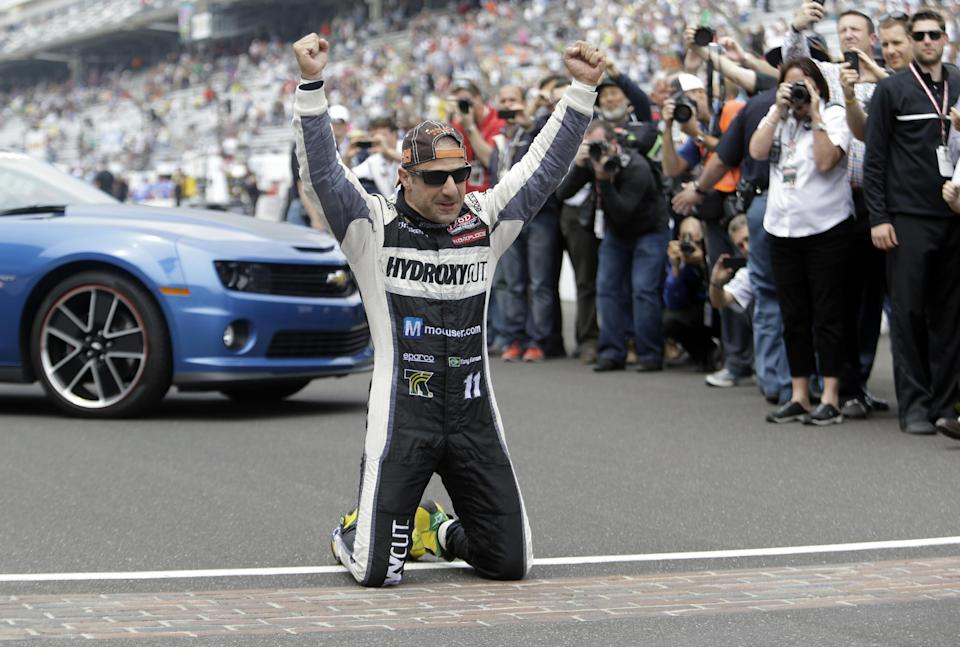 Tony Kanaan, of Brazil, celebrates on the start/finish line after winning the Indianapolis 500 auto race at the Indianapolis Motor Speedway in Indianapolis, Sunday, May 26, 2013. (AP Photo/Tom Strattman)