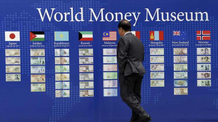 A man looks at a board displaying the world banks' notes in downtown Seoul, South Korea, Tuesday, April 16, 2013. The South Korean government proposed a $15.3 billion stimulus Tuesday to boost slowing growth in Asia's fourth-largest economy. (AP Photo/Lee Jin-man)