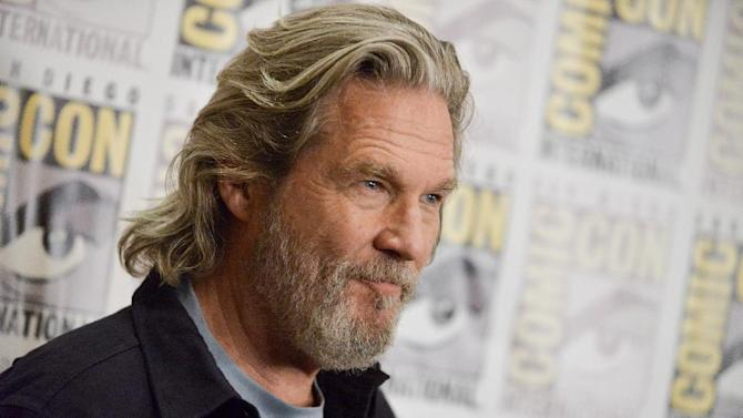 """Jeff Bridges attends """"The Giver"""" press line on Day 1 of Comic-Con International on Thursday, July 24, 2014, in San Diego. (Photo by Richard Shotwell/Invision/AP)"""