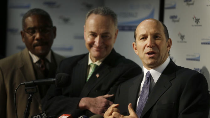 "Cantor Fitzgerald CEO Howard Lutnick, right, speaks during a news conference while Sen. Charles Schumer, center, and Congressman Gregory Meeks listen at a school auditorium in the Rockaways section of New York, Thursday, Jan. 10, 2013. The New York City financial services firm that lost the most workers in the Sept. 11 terror attacks announced that it will ""adopt"" 19 schools in communities hit hard by Superstorm Sandy and give a total of $10 million to families in those schools. (AP Photo/Seth Wenig)"