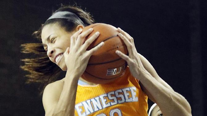 Tennessee's Isabelle Harrison (20) pulls down a rebound near Kentucky's Jelleah Sidney (12) during the second half of an NCAA college basketball game in Lexington, Ky., Thursday, Jan. 29, 2015. Tennessee won 73-72. (AP Photo/James Crisp)