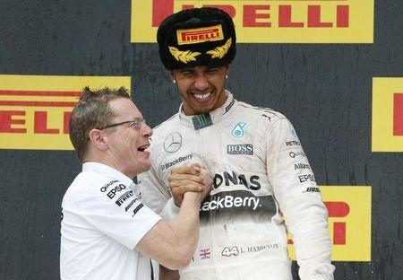 Mercedes F1 driver Hamilton celebrates winning the Russian F1 GP with Cowell in Sochi