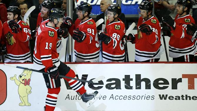 Toews scores 2 to help Blackhawks beat Hurricanes 5-2