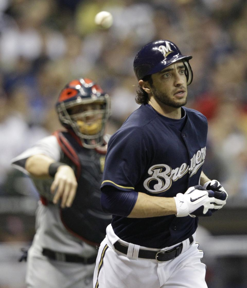 St. Louis Cardinals catcher Yadier Molina throws to first after Milwaukee Brewers' Ryan Braun strikes out during the third inning of Game 2 of baseball's National League championship series Monday, Oct. 10, 2011, in Milwaukee. (AP Photo/David J. Phillip)