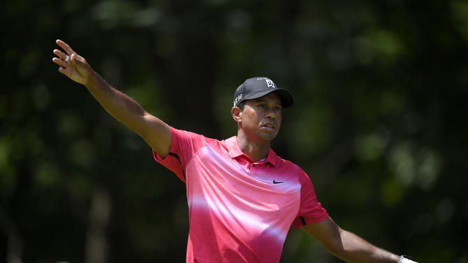 Tiger Woods reacts to his tee shot on the eighth hole during the final round of the Quicken Loans National golf tournament at the Robert Trent Jones Golf Club in Gainesville, Va., Sunday, Aug. 2, 2015. (AP Photo/Nick Wass)