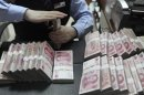 China central bank eyes reform, more flexible yuan inside 2013