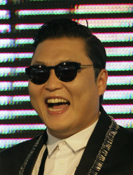"South Korean rapper PSY, who sings the popular ""Gangnam Style,"" smiles while greeting Thai fans during a press conference in Bangkok, Thailand, Wednesday, Nov. 28, 2012. PSY will perform in Thailand on Wednesday night - his first show in Asia outside of South Korea. (AP Photo/Sakchai Lalit)"
