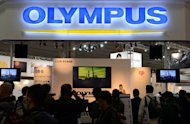An Olympus booth at a photo-imaging show in Yokohama, on January 31, 2013. A Japanese court has handed suspended sentences to three former Olympus executives accused of engineering a massive accounting fraud at the camera and medical equipment maker