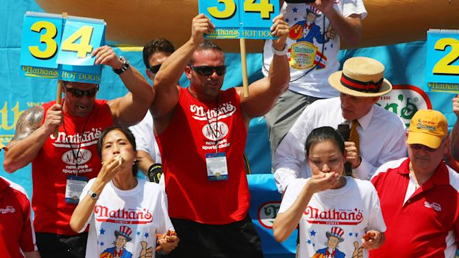 Sonya Thomas and Juliet Lee compete at the Nathan's Hot Dog Eating Contest