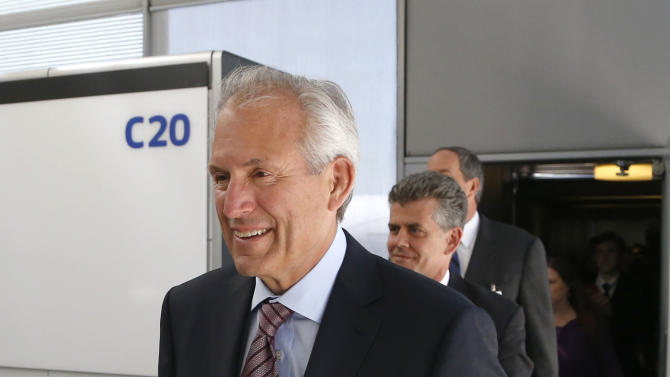Jim McNerney, Chairman and CEO, The Boeing Company, arrives on United Airlines Flight # 1, a Boeing 787 Dreamliner aircraft from Houston, Texas, at Chicago's O'Hare International Airport Monday, May 20, 2013. The planes are returning after being grounded for four months by the federal government because of smoldering batteries on 787s owned by other airlines. (AP Photo/Charles Rex Arbogast)