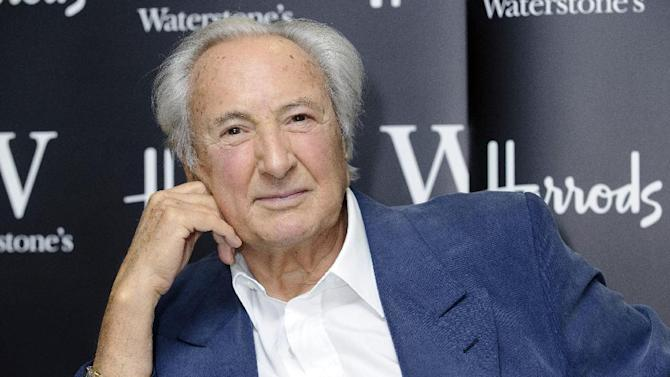 FILE - In this Tuesday, Dec. 14, 2010 file photo, British director and producer, Michael Winner, signs copies of his autobiography, Unbelievable!, at a central London venue. Film director and restaurant critic Michael Winner has died, his wife Geraldine announced Monday, Jan. 21, 2013.  He was 77.  (AP Photo/Jonathan Short, File)