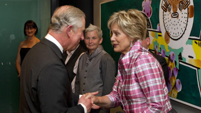 Britain's Prince Charles, left, meets New Zealand's Maori soprano, Kiri Te Kanawa at a Diamond Jubilee Trust Reception and Dinner in Auckland, New Zealand, Monday, Nov. 12, 2012. (AP Photo/SNPA, David Rowland)  NEW ZEALAND OUT