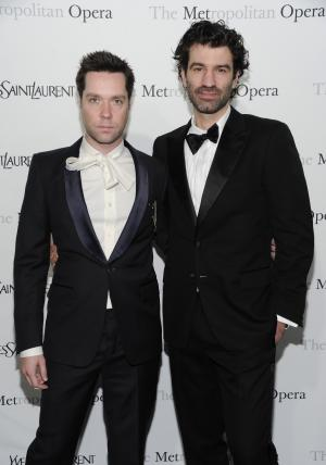 """Singer Rufus Wainwright, left, and boyfriend Jorn Weisbrodt attend the Metropolitan Opera's premiere of """"Le Comte Ory,"""" sponsored by Yves Saint Laurent in New York. Publicist Bianca Bianconi confirmed Wainwright and Jorn Weisbrodt were married in a ceremony Thursday, Aug. 23, 2012. (AP Photo/Evan Agostini, File)"""