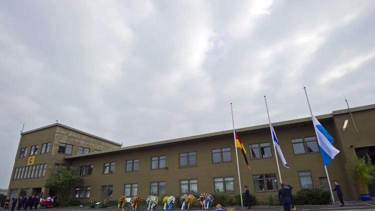 Soldiers stand next to the flags of Germany, Israel and Bavaria, from left, waving at half-mast during a commemoration ceremony for the assassination victims of the Olympic games in Munich in 1972, at the former airbase in Fuerstenfeldbruck, southern Germany, Wednesday, Sept. 5, 2012. Relatives of Israelis slain by Palestinian gunmen during the games and survivors of the attack are marking its 40th anniversary with German politicians and Jewish leaders at the air base where most of the 12 victims died. Also five terrorists were killed in the failed liberation attempt. (AP Photo/dapd, Lennart Preiss)