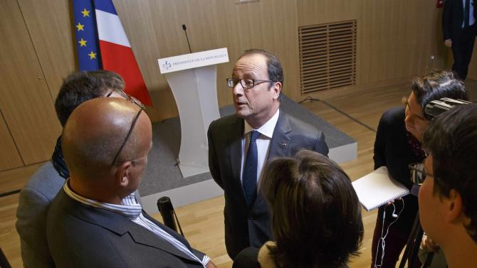 French President Francois Hollande, talks to the media after he delivered a speech to react to the Noble Peace Prize announcement, while visiting an archaeological school in Paris