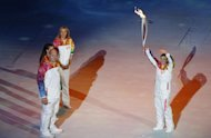 Sochi Winter Olympics 2014: President Putin's Girlfriend Alina Kabayeva Carries Olympic Torch