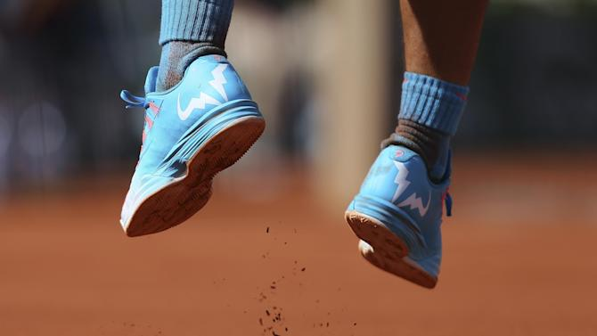 The number 9 is sown onto the shoes of Spain's Rafael Nadal for nine French Open victories in the quarterfinal match of the French Open tennis tournament against Serbia's Novak Djokovic at the Roland Garros stadium, in Paris, France, Wednesday, June 3, 2015. Djokovic won in three sets 7-5, 6-3, 6-1. (AP Photo/David Vincent)