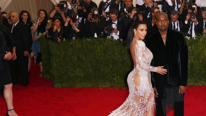 "Kim Kardashian and Kanye West arrive at the Metropolitan Museum of Art Costume Institute Gala 2015 celebrating the opening of ""China: Through the Looking Glass,"" in Manhattan"