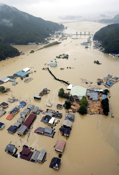Heavy downpours by Typhoon Talas swamp a residential area in Kiho, central Japan, Sunday, Sept. 4, 2011. The center of the season's 12th typhoon was moving slowly north across the Sea of Japan, the Japan Meteorological Agency said. (AP Photo/Kyodo News) JAPAN OUT, MANDATORY CREDIT, NO LICENSING IN CHINA, FRANCE, HONG KONG, JAPAN AND SOUTH KOREA