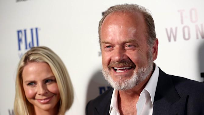 "IMAGE DISTRIBUTED FOR FIJI WATER - Actor Kelsey Grammer, right, and Kayte Walsh arrive at the premiere of ""To The Wonder"" hosted by FIJI Water on Tuesday, April 9, 2013 in Los Angeles. (Photo by Matt Sayles/Invision for Fiji Water/AP Images)"