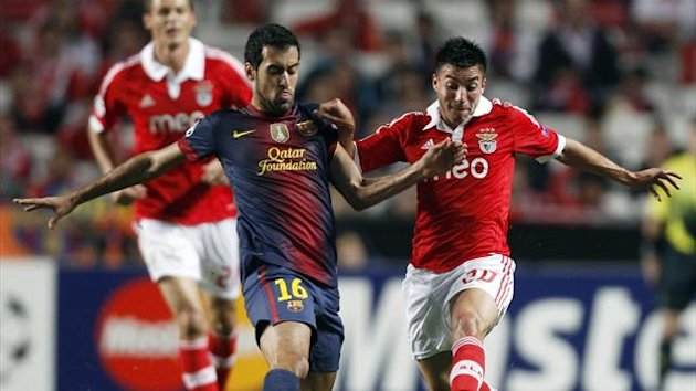 Barcelona's Busquets is challenged by Benfica's Gaitan during their Champions League soccer match in Lisbon
