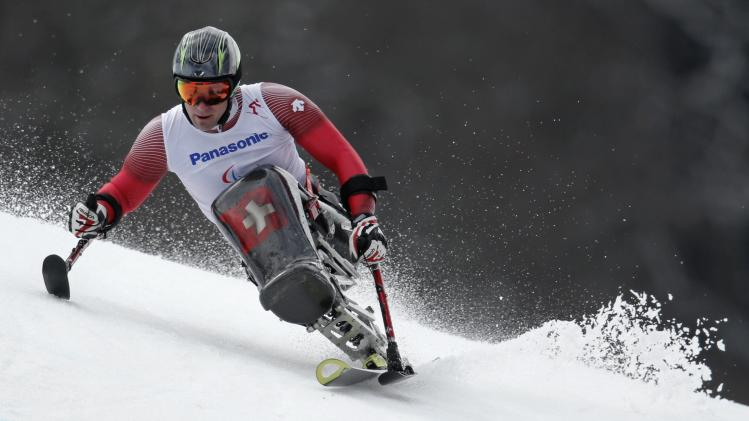 Switzerland's Kunz skis during the men's sitting skiing event of the Giant Slalom at the 2014 Sochi Paralympic Winter Games at the Rosa Khutor Alpine Center