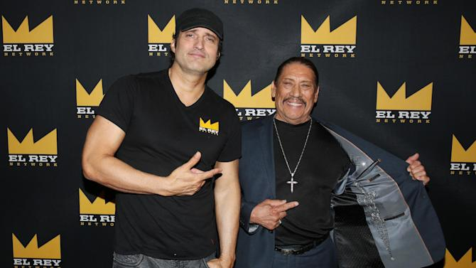 """IMAGE DISTRIBUTED FOR EL REY NETWORK - Robert Rodriguez, Founder and Chairman of El Rey Network, left, and Danny Trejo pose for a photo before the El Rey Network """"From Dusk Till Dawn: The Series"""" panel during the 2015 Summer TCA in Beverly Hills, Calif. on Thursday, July 30, 2015. (Photo by Matt Sayles/Invision for El Rey Network/AP Images)"""