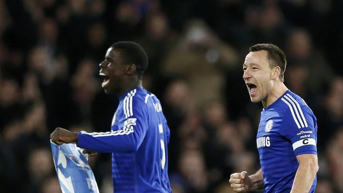 Chelsea's Terry and Zouma celebrate beating Liverpool in their English League Cup semi-final second leg soccer match in London