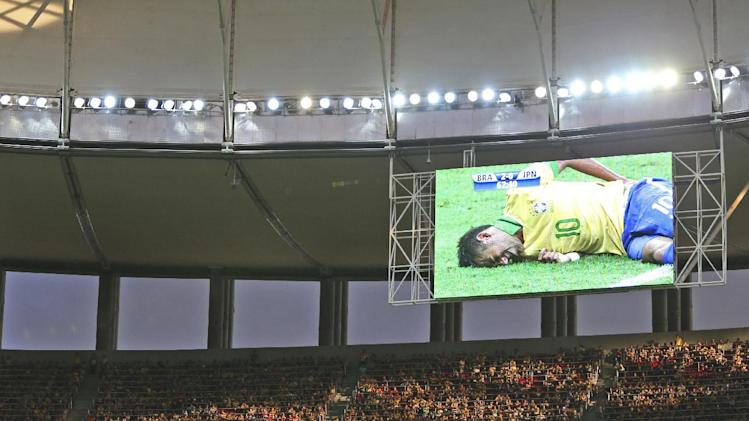 In this June 15, 2013 file photo, Brazil's Neymar is seen on a giant screen as he was injured during the opening match between Brazil and Japan in group A of the soccer Confederations Cup at the National Stadium in Brasilia, Brazil