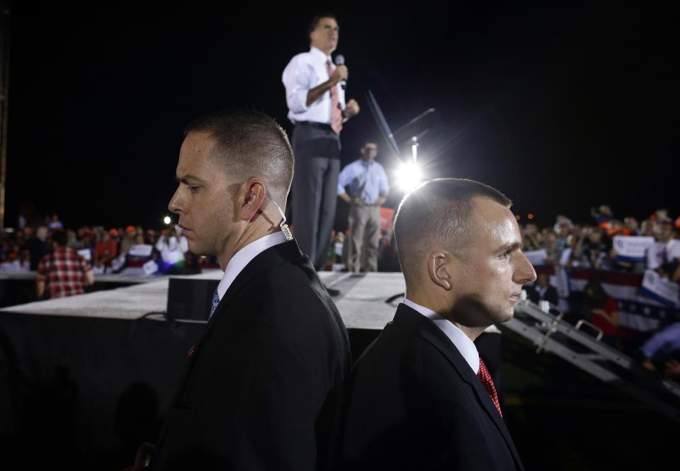 U.S. Secret Service agents stand back to back as Republican presidential candidate and former Massachusetts Gov. Mitt Romney campaigns with vice presidential candidate Paul Ryan in Fishersville, Va., Thursday, Oct. 4, 2012. (AP Photo/Charles Dharapak)