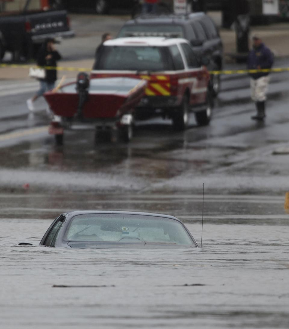 A car submerged in floodwater is seen in Darby, Pa., Friday, Oct. 1, 2010. Torrential downpours from a faded tropical storm inundated the Northeast on Friday, forcing evacuations, toppling trees, cutting power to thousands and washing out roads during a snarled morning commute. (AP Photo/Matt Rourke)