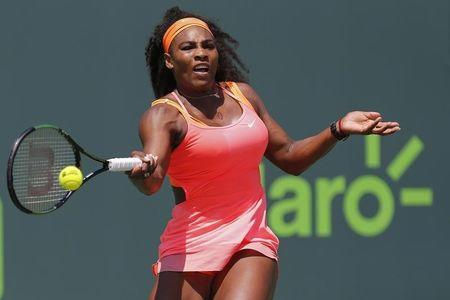 Williams sisters head into last eight in Miami