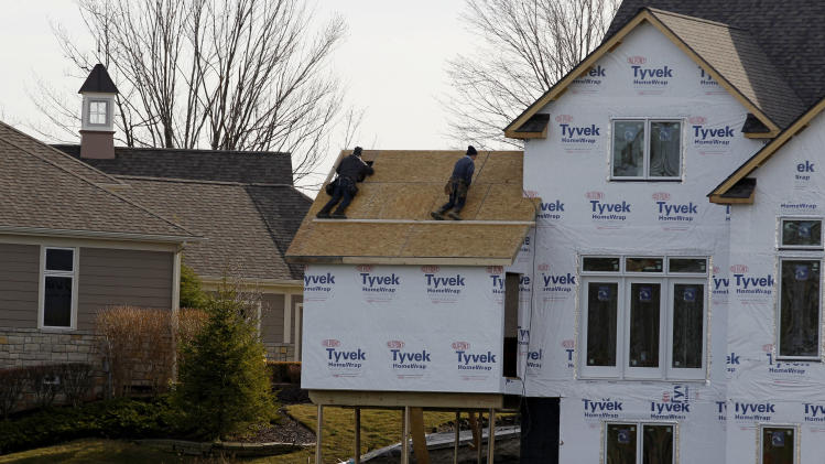 This Thursday, Dec. 6, 2012 photo, shows construction workers framing a new home in Pepper Pike, Ohio. Chemical and bioscience company DuPont Co. reports quarterly earnings on Tuesday, July 23, 2013. (AP Photo/Tony Dejak)