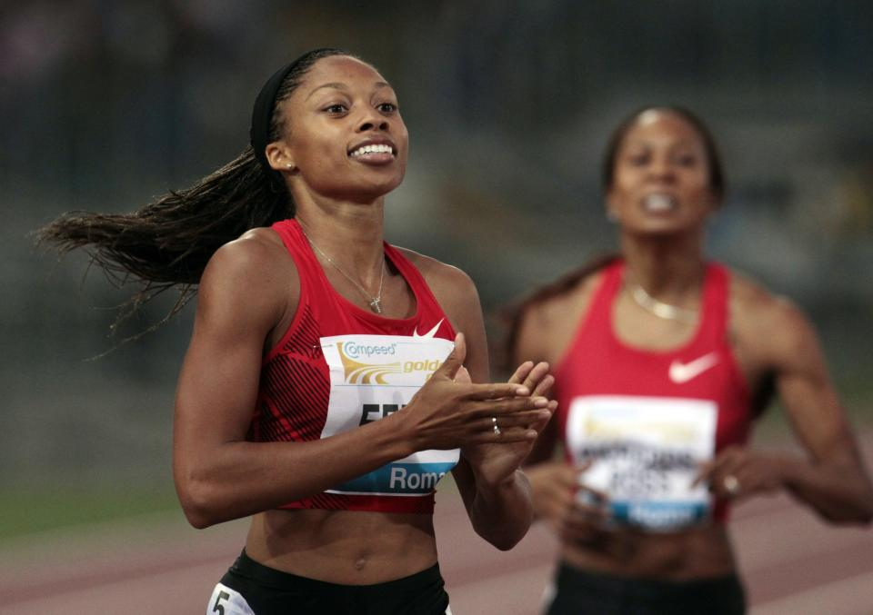 U.S. Allyson Felix celebrates after winning the women's 400m event during the Golden Gala athletics meeting, in Rome, Thursday, May 26, 2011. (AP Photo/Gregorio Borgia)