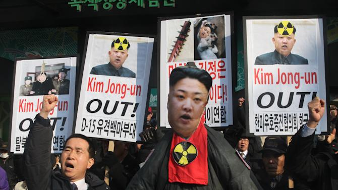 FILE - In this Wed., Feb. 13, 2013 file photo, a South Korean protester shouts slogans near an effigy of North Korean leader Kim Jong Un during an anti-North Korea rally to denounce North Korea's nuclear test in Seoul, South Korea, a day after North Korea defied U.N. warnings with a nuclear test. The Cold War still rages in North Korea, and enemy No. 1 is the United States, which Pyongyang blames for making necessary its much-condemned drive to build nuclear weapons. North Korea's latest nuclear test in February - its third - has led even China, its only major ally, to support a new round of U.N. sanctions. A draft resolution is expected to be circulated this week at the U.N. The West condemns the North's nuclear bombs as a serious threat to Northeast Asia's delicate security and a drain on precious resources that could go to North Korea's largely destitute people. (AP Photo/Ahn Young-joon, File)