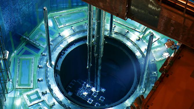 A fuel rod is inserted into a reactor vessel inside the No. 1 reactor building at Kyushu Electric Power's Sendai nuclear power station in Satsumasendai