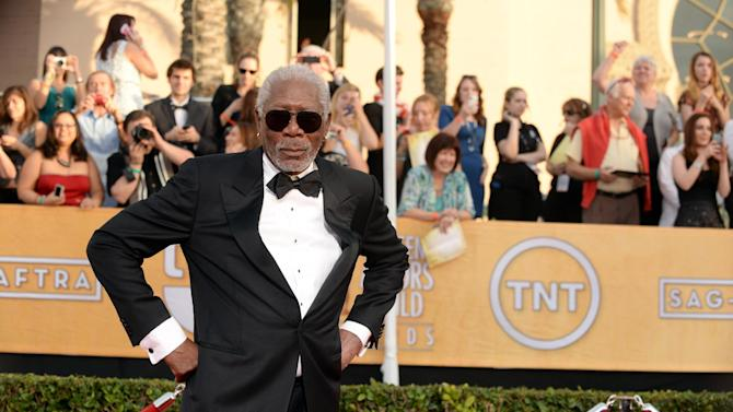 Morgan Freeman arrives at the 20th annual Screen Actors Guild Awards at the Shrine Auditorium on Saturday, Jan. 18, 2014, in Los Angeles. (Photo by Jordan Strauss/Invision/AP)